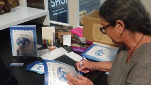 Jeanette Goode signs copies of her new book at the Westport launch 25 Sept 2020