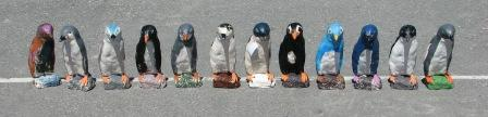 Plaster penguins painted by children